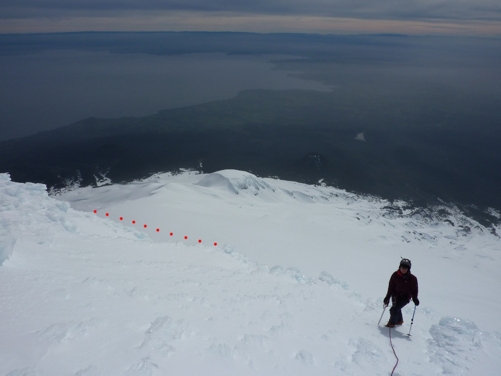 Looking down from the edge of the summit area, showing how far round the cone you need to go to get back.